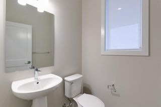 Photo 10: 153 Crestridge Common SW in Calgary: Crestmont Row/Townhouse for sale : MLS®# A1051009