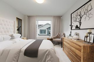 Photo 11: 153 Crestridge Common SW in Calgary: Crestmont Row/Townhouse for sale : MLS®# A1051009