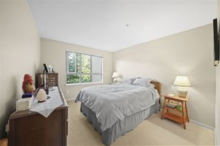 "Photo 11: 211 600 KLAHANIE Drive in Port Moody: Port Moody Centre Condo for sale in ""BOARDWALK"" : MLS®# R2401199"