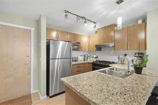 "Photo 2: 211 600 KLAHANIE Drive in Port Moody: Port Moody Centre Condo for sale in ""BOARDWALK"" : MLS®# R2401199"