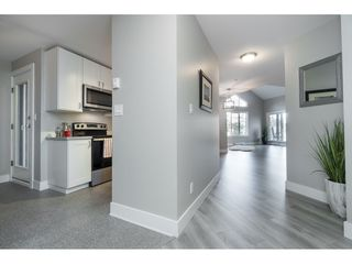 "Photo 3: 406 20288 54 Avenue in Langley: Langley City Condo for sale in ""Langley City"" : MLS®# R2432392"