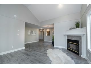 "Photo 12: 406 20288 54 Avenue in Langley: Langley City Condo for sale in ""Langley City"" : MLS®# R2432392"