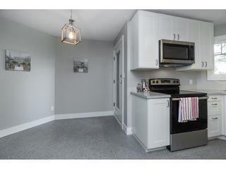 "Photo 5: 406 20288 54 Avenue in Langley: Langley City Condo for sale in ""Langley City"" : MLS®# R2432392"