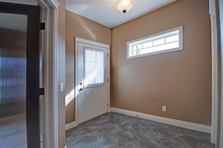 Photo 16: 717 Stonehaven Drive: Carstairs Detached for sale : MLS®# A1030749