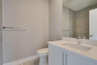 Photo 16: 2208 1 Street NW in Calgary: Tuxedo Park Semi Detached for sale : MLS®# A1016531