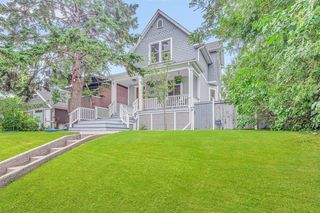 Photo 1: 225 25 Avenue NE in Calgary: Tuxedo Park Detached for sale : MLS®# A1021606
