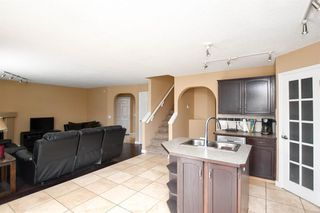 Photo 10: 93 ARBOUR RIDGE Park NW in Calgary: Arbour Lake Detached for sale : MLS®# A1026542