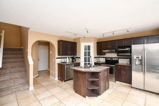 Photo 9: 93 ARBOUR RIDGE Park NW in Calgary: Arbour Lake Detached for sale : MLS®# A1026542