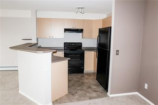 Photo 5: 8427 304 MACKENZIE Way SW: Airdrie Apartment for sale : MLS®# C4285235