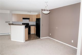 Photo 4: 8427 304 MACKENZIE Way SW: Airdrie Apartment for sale : MLS®# C4285235