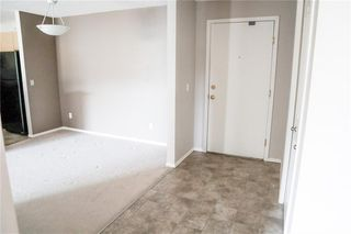 Photo 2: 8427 304 MACKENZIE Way SW: Airdrie Apartment for sale : MLS®# C4285235