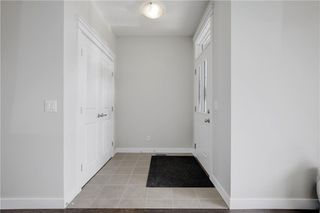 Photo 4: 27 RAVENSTERN Point SE: Airdrie Semi Detached for sale : MLS®# C4286899