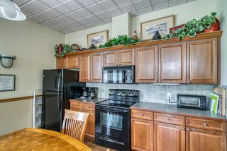 Photo 37: 1210 LAKE FRASER Court SE in Calgary: Lake Bonavista Apartment for sale : MLS®# A1022722