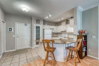 Photo 9: 1210 LAKE FRASER Court SE in Calgary: Lake Bonavista Apartment for sale : MLS®# A1022722