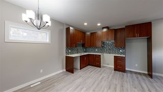 Photo 5: 11810 64 Street NW in Edmonton: Zone 06 Duplex Front and Back for sale : MLS®# E4222511