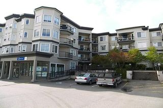 "Photo 1: 5759 GLOVER Road in Langley: Langley City Condo for sale in ""COLLEGE COURT"" : MLS®# F2709459"
