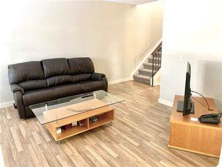 Photo 3: 48 2323 OAKMOOR Drive SW in Calgary: Palliser Row/Townhouse for sale : MLS®# C4272425