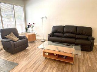 Photo 2: 48 2323 OAKMOOR Drive SW in Calgary: Palliser Row/Townhouse for sale : MLS®# C4272425