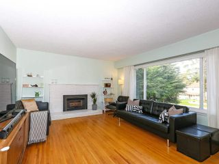 Photo 3: 699 POPLAR Street in Coquitlam: Central Coquitlam House for sale : MLS®# R2435847