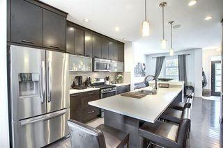 Photo 12: 114A 12 Street NE in Calgary: Bridgeland/Riverside Semi Detached for sale : MLS®# A1014321