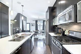 Photo 11: 114A 12 Street NE in Calgary: Bridgeland/Riverside Semi Detached for sale : MLS®# A1014321