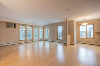 Photo 2: 214 7239 SIERRA MORENA Boulevard SW in Calgary: Signal Hill Apartment for sale : MLS®# C4282554
