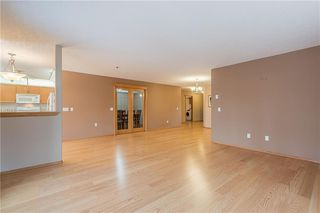 Photo 4: 214 7239 SIERRA MORENA Boulevard SW in Calgary: Signal Hill Apartment for sale : MLS®# C4282554