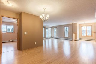 Photo 5: 214 7239 SIERRA MORENA Boulevard SW in Calgary: Signal Hill Apartment for sale : MLS®# C4282554