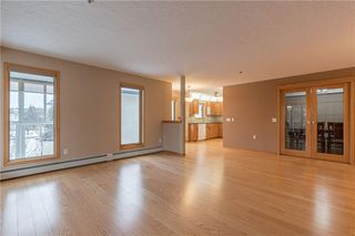 Photo 6: 214 7239 SIERRA MORENA Boulevard SW in Calgary: Signal Hill Apartment for sale : MLS®# C4282554