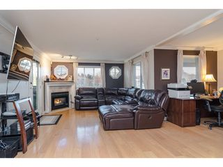 "Photo 4: 101 5909 177B Street in Surrey: Cloverdale BC Condo for sale in ""Carriage Court"" (Cloverdale)  : MLS®# R2446430"