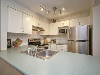 "Photo 11: 102 3099 TERRAVISTA Place in Port Moody: Port Moody Centre Condo for sale in ""THE GLENMORE"" : MLS®# R2500937"