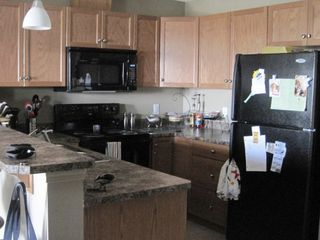 Photo 3: 5951 165 Ave NW in Edmonton: Condo for rent