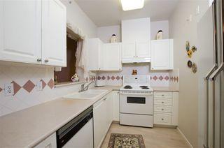 "Photo 2: 420 5518 14 Avenue in Delta: Cliff Drive Condo for sale in ""WINDSOR WOODS"" (Tsawwassen)  : MLS®# R2431173"