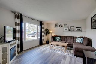 Photo 5: 1308 107 Avenue SW in Calgary: Southwood Detached for sale : MLS®# A1013669
