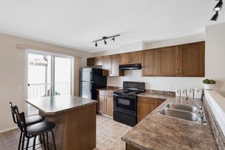 Photo 11: 261 ELGIN Gardens SE in Calgary: McKenzie Towne Row/Townhouse for sale : MLS®# A1031514