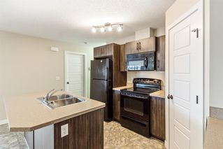 Photo 3: 9103 2781 Chinook Winds Drive SW: Airdrie Row/Townhouse for sale : MLS®# A1056045