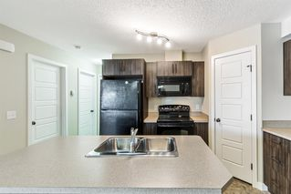 Photo 4: 9103 2781 Chinook Winds Drive SW: Airdrie Row/Townhouse for sale : MLS®# A1056045