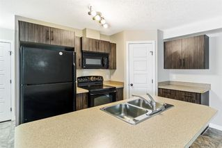 Photo 2: 9103 2781 Chinook Winds Drive SW: Airdrie Row/Townhouse for sale : MLS®# A1056045