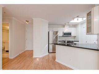 """Photo 12: 405 150 W 22ND Street in North Vancouver: Central Lonsdale Condo for sale in """"The Sierra"""" : MLS®# R2416817"""