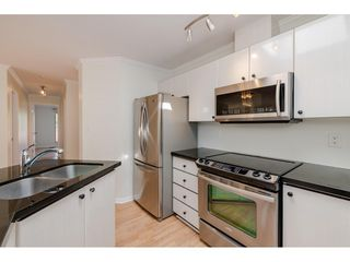 """Photo 9: 405 150 W 22ND Street in North Vancouver: Central Lonsdale Condo for sale in """"The Sierra"""" : MLS®# R2416817"""