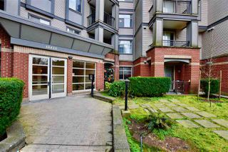 "Photo 1: 213 10455 UNIVERSITY Drive in Surrey: Whalley Condo for sale in ""D'Cor"" (North Surrey)  : MLS®# R2443325"