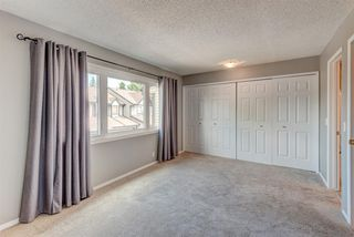 Photo 9: 21 12625 24 Street SW in Calgary: Woodbine Row/Townhouse for sale : MLS®# A1011993