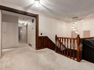 Photo 17: 384 STRATHCONA Drive SW in Calgary: Strathcona Park Detached for sale : MLS®# A1026047