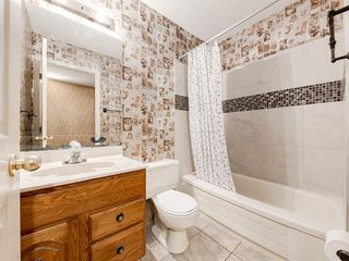 Photo 13: 384 STRATHCONA Drive SW in Calgary: Strathcona Park Detached for sale : MLS®# A1026047