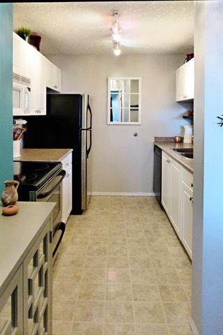 Photo 7: 1405 Millrise Point SW in Calgary: Millrise Apartment for sale : MLS®# A1050643