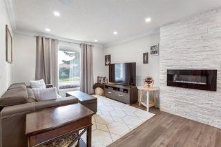 Photo 3: 6528/6528B 23 Avenue NE in Calgary: Pineridge Detached for sale : MLS®# A1033640
