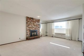 Photo 3: 6135 TOUCHWOOD Drive NW in Calgary: Thorncliffe Detached for sale : MLS®# C4291668