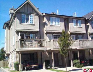 "Photo 1: 8775 161ST Street in Surrey: Fleetwood Tynehead Townhouse for sale in ""Ballantyne"" : MLS®# F2706540"
