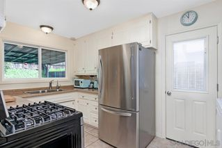Photo 11: CLAIREMONT House for sale : 4 bedrooms : 5174 Acuna St in San Diego