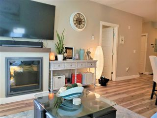 "Photo 3: 108 19936 56 Avenue in Langley: Langley City Condo for sale in ""Bearing Pointe"" : MLS®# R2442185"